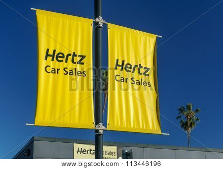 Hertz Car Sales Sign And Logo