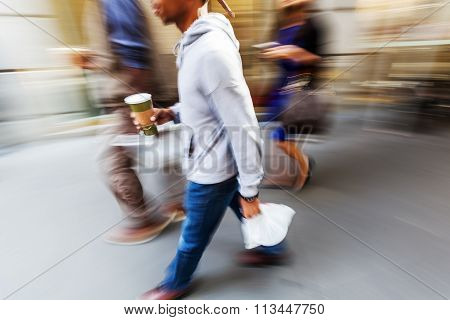walking man in the city in motion blur