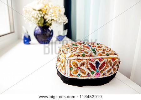 Colorful skullcap hat on the windowsill