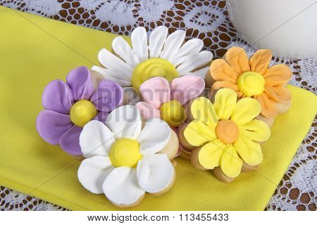 Flower Sugar Cookies yellow napkin white lace table cloth