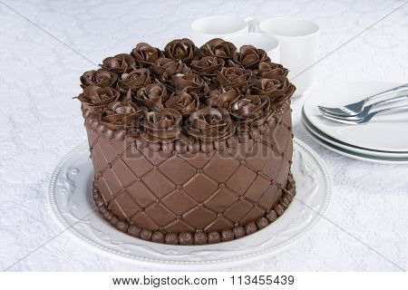 Triple Chocolate rose frosting cake on white plate
