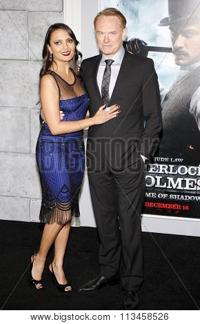 WESTWOOD, CALIFORNIA - December 6, 2011. Jared Harris and Allegra Riggio at the Los Angeles premiere of