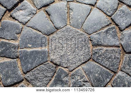 Ancient paving. Sidewalk street paved with cobblestones.
