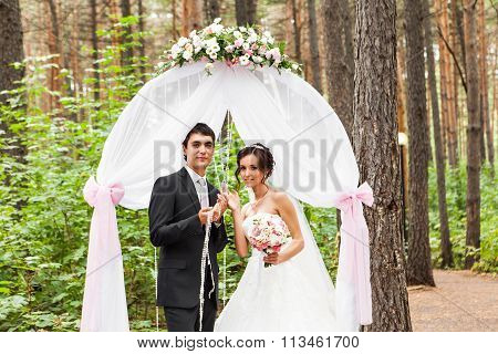 Couple Getting Married at an Outdoor Wedding Ceremony