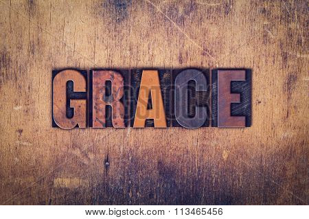 "The word ""Grace"" written in dirty vintage letterpress type on a aged wooden background. poster"