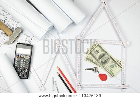 White Meter Tool Forming A House And Tools On White Paper Background