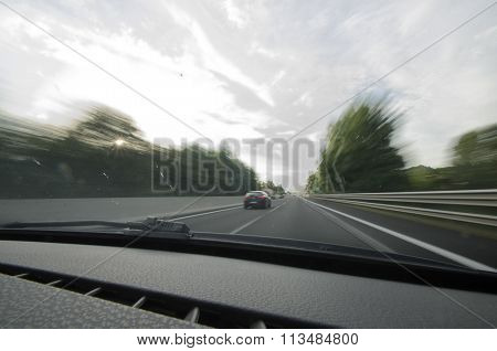 Car Overtaking On A Highway