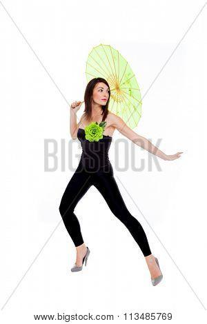 Dancer with umbrella over white background