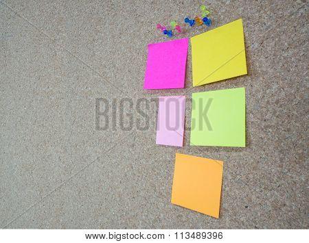 Group Of Thumbtacks Pinned And Colorful Memorandum Notes On Cork Board (bulletin Board)