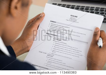 Businesswoman Hand Holding Resume