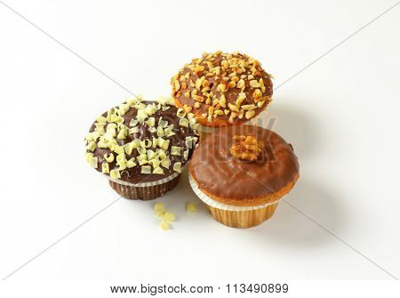 Assorted muffins - one chocolate muffin, two muffins with nuts