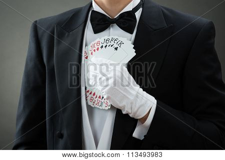 Magician Putting Fanned Out Cards In Suit