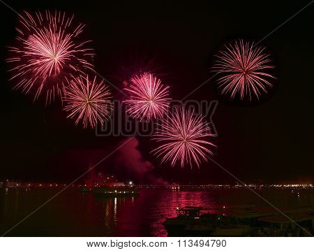 Big red fireworks explode in Venice in dark sky,New Year fireworks in Venice, 4 July, Independence,