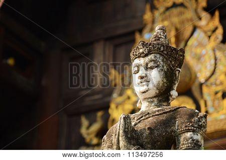 White praying Buddha statue