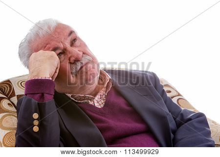 Elderly Retired Man Relaxing In A Chair