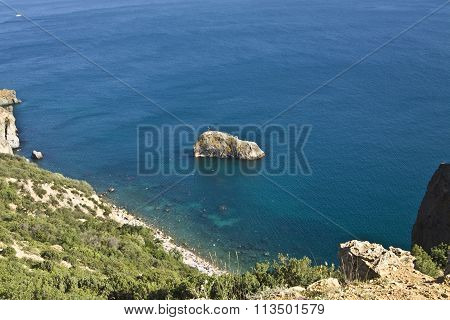 Sea landscape with rock in water recorded in place Fiolent in region Crimea on Black sea.