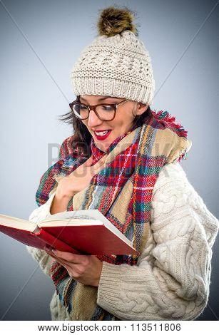 Pretty Young Woman Enjoying Her Book