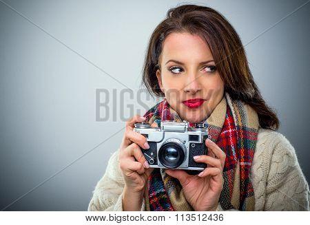 Attractive Woman With A Retro Camera