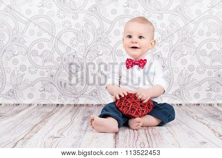 Baby Playing With Red Heart