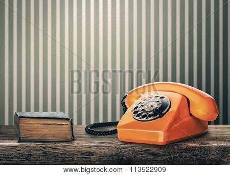 Vintage Phone And Book On A Table