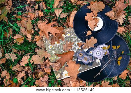 Old Cassettes And Records With Fallen Leaves, Vintage Style