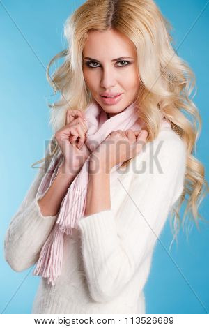 Portrait of a Woman in autumn clothes on blue background