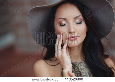 Fashionable girl in hat outdoor
