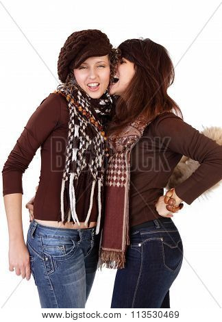 Two Happy Young Girlfriends Talking Isolated Over White