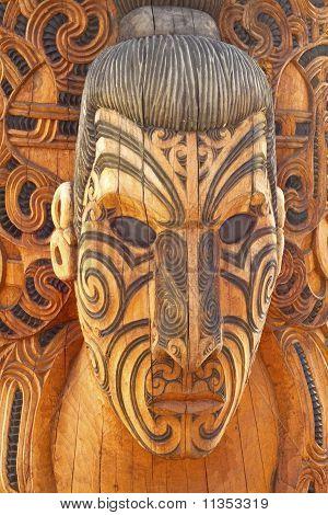 Carved and tattooed Maori statue
