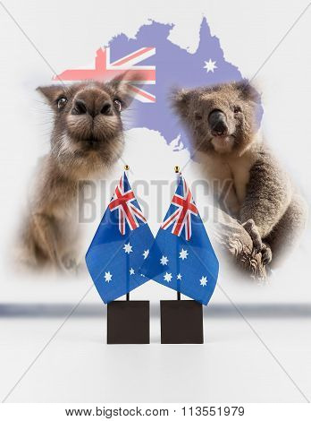 Two Australian Desk Flags, Koala And Kangaroo With Map Of Australia In The Background.
