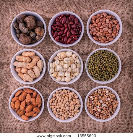 Mixed Beans , Lentils And Nuts In The White Bowl On Brown Cloth Sack  Background. Mung Bean, Groundn