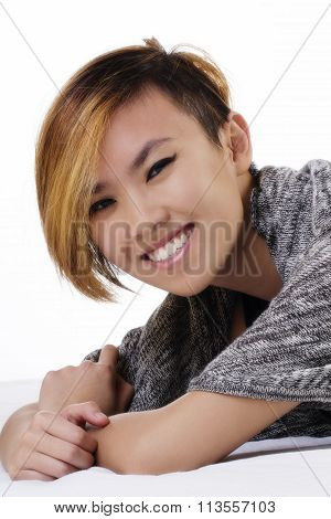 Smiling Asian American Woman On Stomach Short Hair