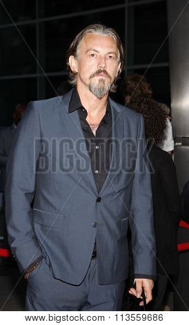 HOLLYWOOD, CALIFORNIA - August 30, 2011. Tommy Flanagan at the Season 4 premiere of FX Network's