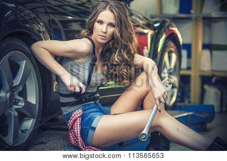 Beautiful Sexy Woman Working To Repair The Car In The Showroom
