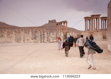 Visitors Walking In The Ruins Of The Ancient City Of Palmyra, Syrian Desert