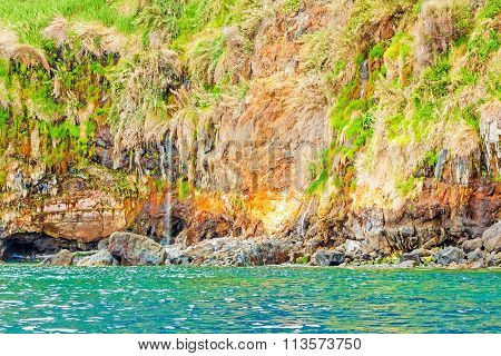 Colorful rocky cliff coast of Madeira between Jardim do Mar and Calheta poster