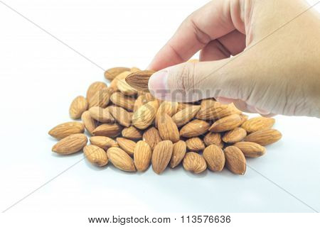 Hand On Almond Grain Isolated On White Background