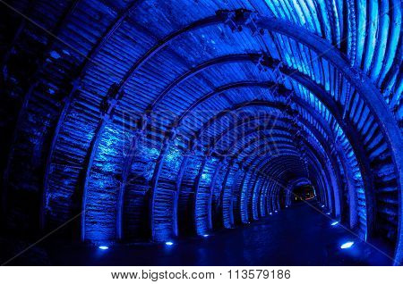 Blue light tunnel in underground salt cathedral Zipaquira
