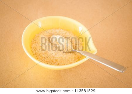 A Pile Of Brown Sugar In Little Bowl