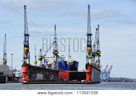 Ship At The Dock On Elbe River, Hamburg, Germany.