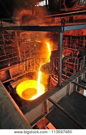 Liquid metal from blast furnace on trail