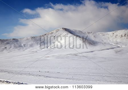 Snow-covered hills. Mongolian winter landscape
