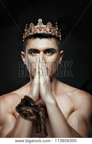 Man Crown On His Head To Pray With Folded Hands.