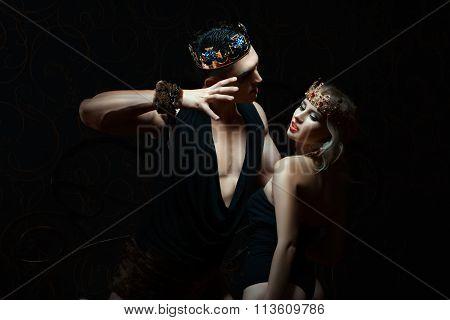 Man Holds Girl Passionately.