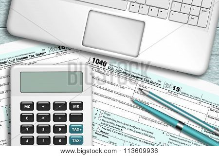 Calculator With Tax Form 1040 Lying On Wooden Desk