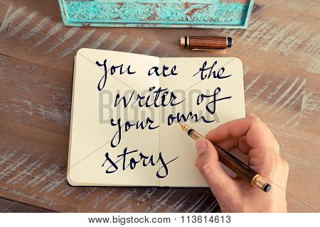 Retro effect and toned image of a woman hand writing a note with a fountain pen on a notebook. Motivational concept with handwritten text YOU ARE THE WRITER OF YOUR OWN STORY poster