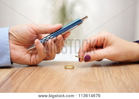 Husband Is Giving Pen To Sign Divorce Papers His Former Wife After He Take Off The Ring Form Finger,
