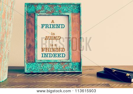 Motivational Quote Written On Vintage Photo Frame A Friend In Need Is A Friend Indeed
