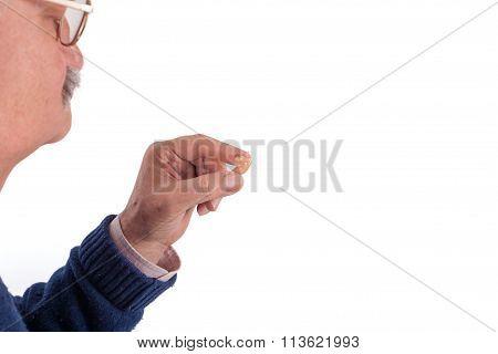 Senior Man And His Hearing Aid
