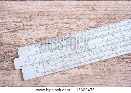 Historic Slide Rule Lying On Wooden Table